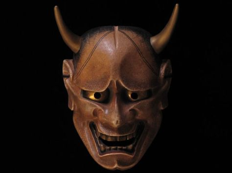 The Hannya (般若) mask is a mask used in Noh theater, representing a jealous female demon. It possesses two sharp bull-like horns, metallic eyes, and a leering mouth.